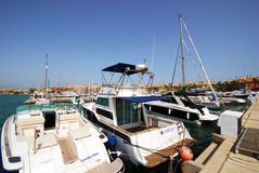 Boats in Sotogrande marina. Yachts and boats in the marina with buildings to the rear, Puerto Sotogrande, Cadiz Province, Andalucia, Spain, Western Europe Royalty Free Stock Image