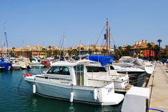 Boats in Sotogrande marina. Yachts and boats in the marina with buildings to the rear, Puerto Sotogrande, Cadiz Province, Andalucia, Spain, Western Europe Royalty Free Stock Images