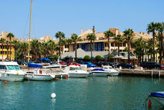 Boats in Sotogrande marina. Yachts and boats in the marina with buildings to the rear, Puerto Sotogrande, Cadiz Province, Andalucia, Spain, Western Europe Royalty Free Stock Photos
