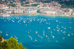 Boats and speedboats parked offshore.  Stock Photos