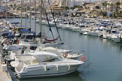 Boats in sports port of El campello, alicante, spain. Horizontal view of some boats inside sports port in the coastal municipality of El campello in the province stock image