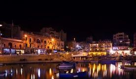 Boats at  St. Julian's bay in night. Boats at quay in St. Julian's bay in night. Malta Royalty Free Stock Photos