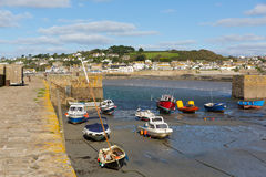 Boats in St Michaels Mount harbour Cornwall England UK Stock Photos