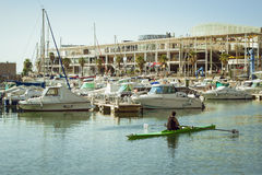 A boats stands on the dock at the waterfront Alicante. ALICANTE, SPAIN - SEPTEMBER 9, 2014: a boats stands on the dock at the waterfront, Alicante, Spain Stock Photography
