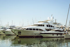 A boats stands on the dock at the waterfront Alicante. ALICANTE, SPAIN - SEPTEMBER 9, 2014: a boats stands on the dock at the waterfront, Alicante, Spain Royalty Free Stock Images