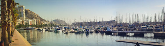 A boats stands on the dock at the waterfront Alicante. ALICANTE, SPAIN - SEPTEMBER 9, 2014: a boats stands on the dock at the waterfront, Alicante, Spain Royalty Free Stock Image