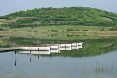 Boats on still water. Reflections of docked boats on Inner lake, Tihany Hungary Stock Photo