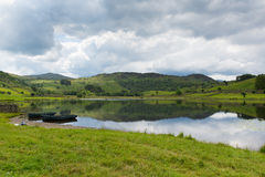Boats and still water Watendlath Tarn Lake District Cumbria England UK Royalty Free Stock Images
