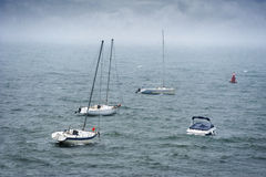 Boats in stormy sea Royalty Free Stock Photography