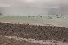 Boats in stormy weather at Banks Peninsula Stock Photography