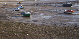 Boats stranded at low tide royalty free stock photos