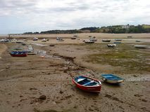 Boats stuck in low tide stock image