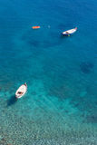 Boats and stunning sea colours in Italy Royalty Free Stock Photography