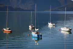 Boats in a summer day on Lake Como, Italy Royalty Free Stock Photos