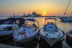 Boats at sunrise at Mandraki harbor. Rhodes, Greece royalty free stock photos