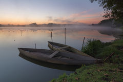 Boats at sunrise Stock Images