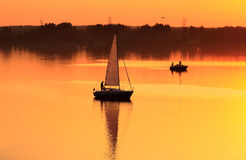 Boats at sunset. Boats on the lake at sunset Royalty Free Stock Photos