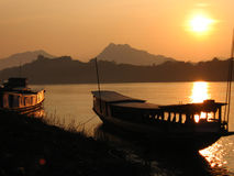 Boats at sunset. Big boats on Mekhong bank at sunset Stock Photo