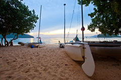 Boats and Sunset. Boats on a beach at Langkawi, Malaysia Stock Photo