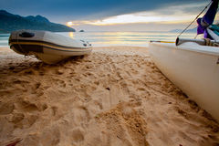 Boats and Sunset. Boats on a beach at Langkawi, Malaysia Stock Images