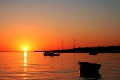 Boats at sunset Royalty Free Stock Photos