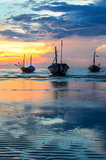 Boats with sunset Stock Images