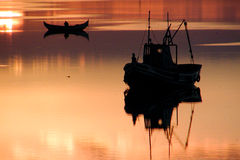 Boats at sunset Royalty Free Stock Photos