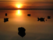 Boats at sunset. Boats moored at sunset Royalty Free Stock Photos