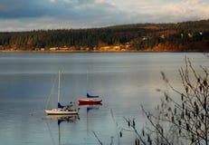 Boats at sunset. Two sailboats docked at sunset Royalty Free Stock Photos