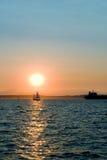 Boats at sunset Stock Image