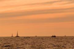 Boats at sunset royalty free stock image