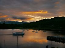 Boats at sunset, Ambleside, Lake District, England. Popular visitor destination ambleside at sunset Royalty Free Stock Photography