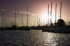 Boats on sunset. Stock Photos