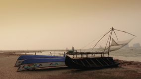 Boats at sunset on beach,  Fort Kochi, South India stock footage