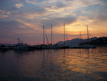 Boats at Sunset. Beautiful sunset in Baska Voda, Croatia royalty free stock image