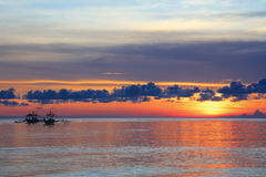 Boats at sunset at Diniwid Beach, Boracay Island, Philippines Stock Photo