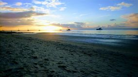 Boats in the sunset at Fraser Island stock photos