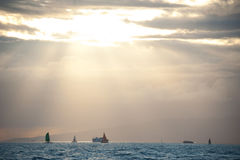 Boats at Sunset. A group of boats is soaked in sunshine just before sunset off the coast of Waikiki in Oahu, Hawaii Stock Photography
