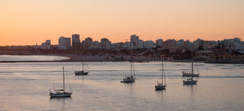 Boats at sunset in the harbor, Portimao city, Portugal Stock Images