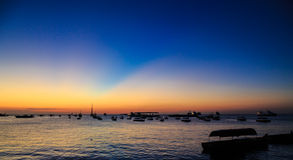 Boats at sunset lying in the harbour of Stonetown Zanzibar Stock Images