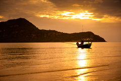 Boats in sunset after the mountain Royalty Free Stock Photography
