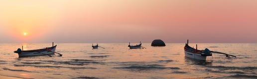 Boats at sunset Stock Photos