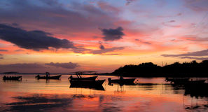 Boats at sunset. Boats at rest under the Caribbean sunset Royalty Free Stock Photography