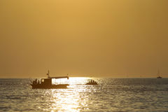 Boats at sunset Stock Images