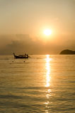 Boats sunset in the sea Stock Photography