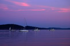 Boats at sunset in shore of Lopez Stock Image