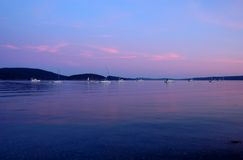 Boats at sunset in shore of Lopez Island Stock Photo