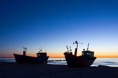 Boats with sunset sky environment Royalty Free Stock Photos