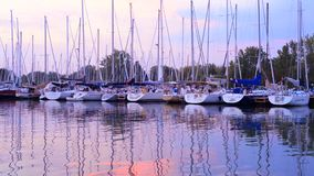 Boats at sunset in Toronto marina stock video