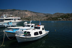 Boats of Symi. Some boats in the bay of Panormitis bay on Symi Island, Greece stock photography
